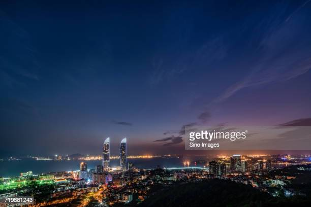 skyline of illuminated modern buildings at night, xiamen, fujian, china - xiamen fotografías e imágenes de stock