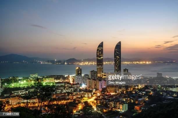 skyline of illuminated modern skyscrapers at night, xiamen, fujian, china - xiamen stock photos and pictures