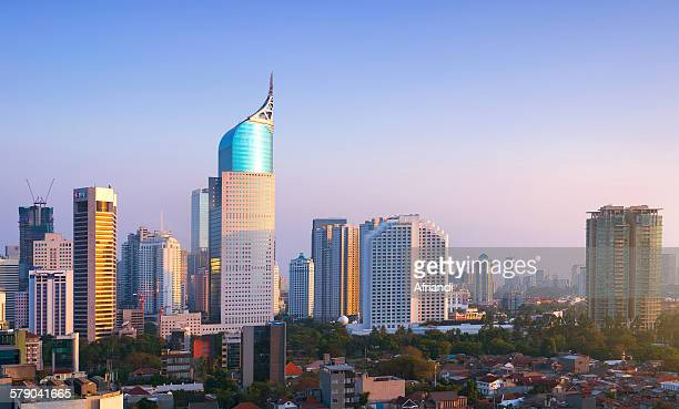 skyline of jakarta business district - jakarta stock pictures, royalty-free photos & images