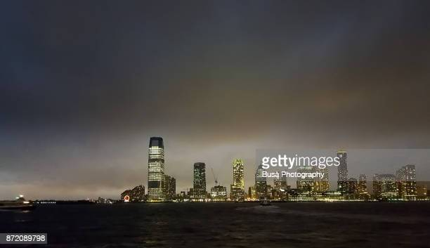 Skyline of Jersey City at night as seen from Lower Manhattan, New York City