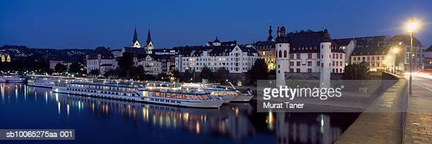 Skyline of Koblenz reflecting in river at dusk