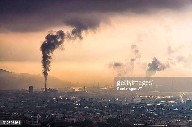 skyline of linz and heavy industry in upper austria - linz stock pictures, royalty-free photos & images