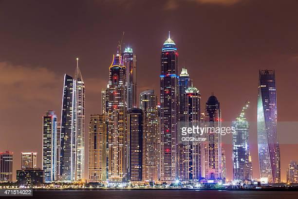Skyline of lit up buildings in Dubai