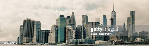 skyline of lower manhattan's financial district from across the east river. new york city, usa - one world trade center stock pictures, royalty-free photos & images