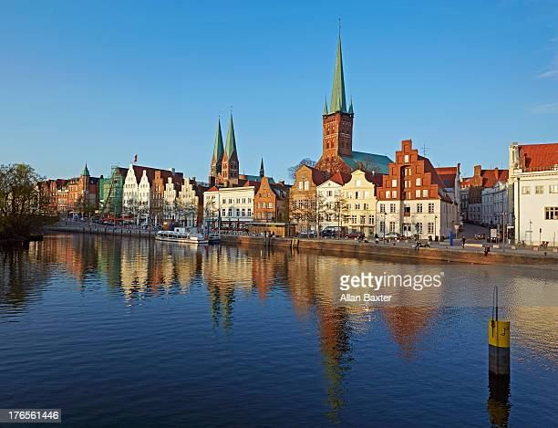 Skyline of Lubeck Altstadt by river