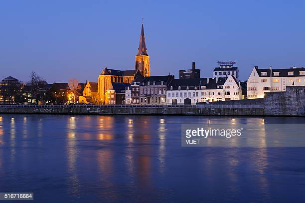 skyline of maastricht at night - meuse river stock photos and pictures