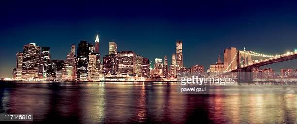 Skyline of Manhattan with Brooklyn bridge by night