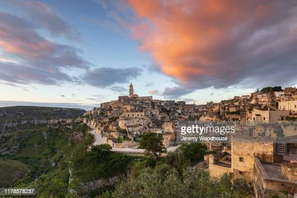 skyline of matera at sunrise - jeremy woodhouse stock pictures, royalty-free photos & images