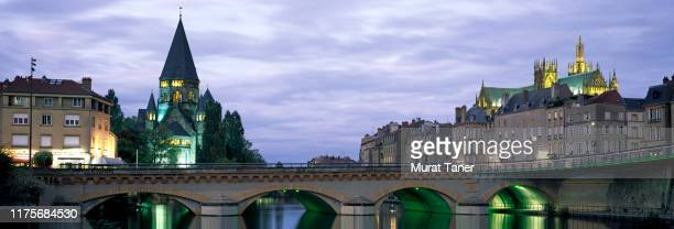 skyline of metz on the moselle river at dusk - moselle france stock pictures, royalty-free photos & images