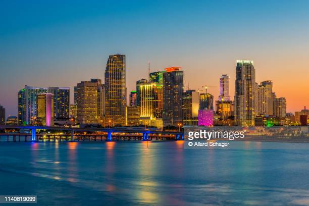 skyline of miami florida usa at sunset - miami foto e immagini stock