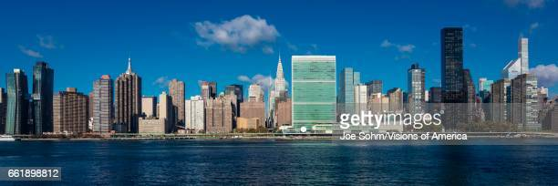 NEW YORK Skyline of Midtown Manhattan seen from the East River showing the Chrysler Building and the United Nations building New York
