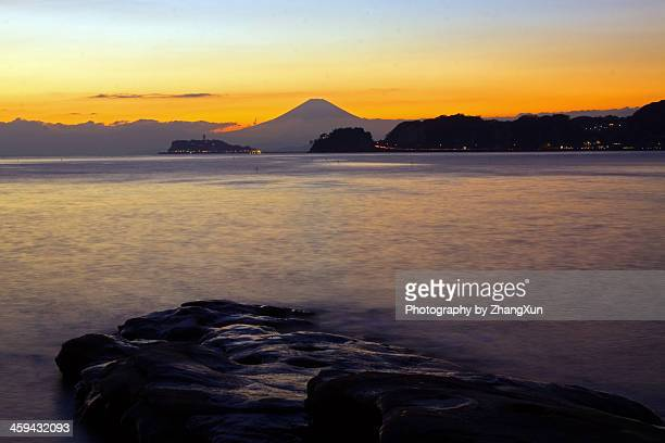 Skyline of Mount fuji over sea at Shonan at dark