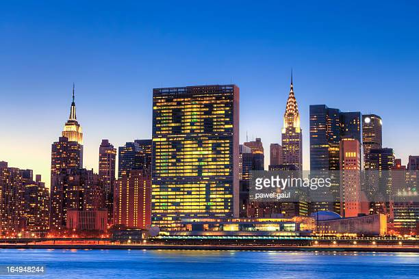 skyline of new york city - united nations stock pictures, royalty-free photos & images