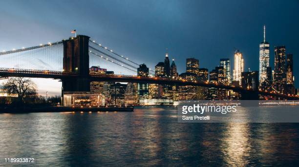 skyline of new york from dumbo - brooklyn bridge stock pictures, royalty-free photos & images