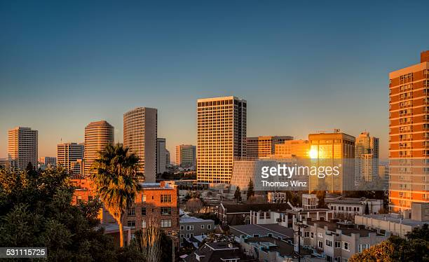skyline of oakland at sunrise - oakland california skyline stock pictures, royalty-free photos & images
