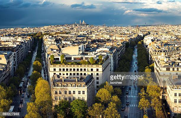 skyline of paris with sacre coeur at sunset - place charles de gaulle paris stock photos and pictures