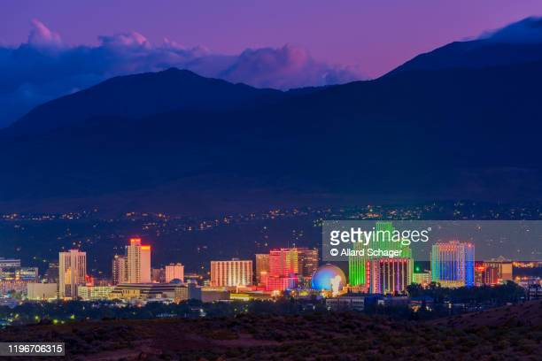 skyline of reno nevada at dusk - nevada stock pictures, royalty-free photos & images