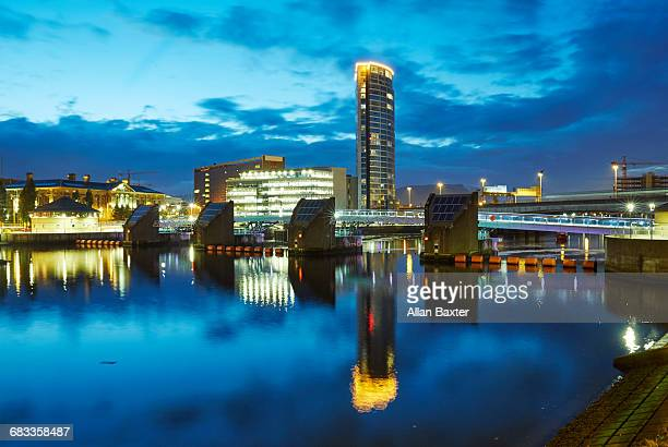 skyline of river weir in belfast at dusk - twilight stock pictures, royalty-free photos & images