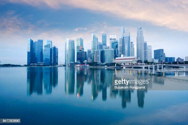 skyline of singapore by the marina bay - singapore stock photos and pictures