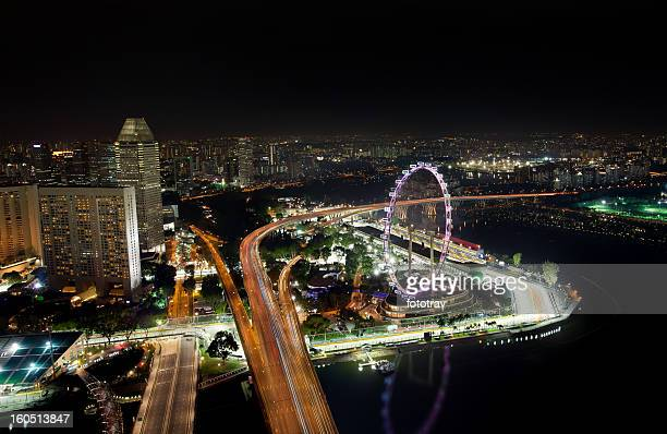 skyline of singapore with view on the f1 race track - singapore city stock photos and pictures