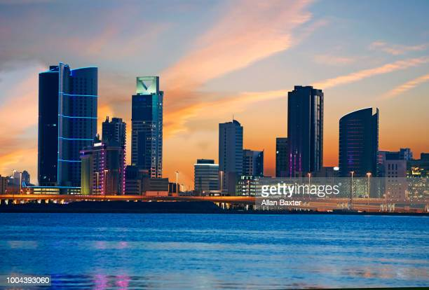 skyline of the diplomatic quarter of manama at twilight - manama stock pictures, royalty-free photos & images