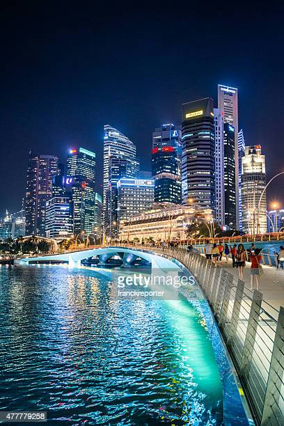 skyline of the singapore downtown at night from the marina - singapore stock photos and pictures