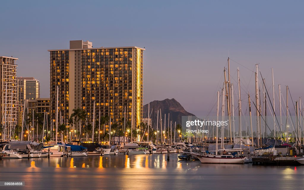 Skyline Of Waikiki At Night Or Dusk With Yachts And Boats In Ala ...