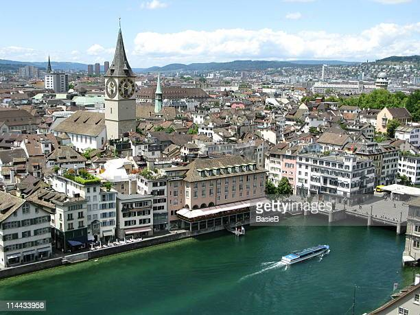 Skyline of Zuerich showing buildings and waterway with ferry