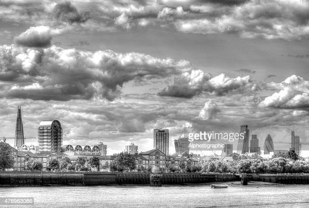 skyline over the thames in london - monument station london stock photos and pictures