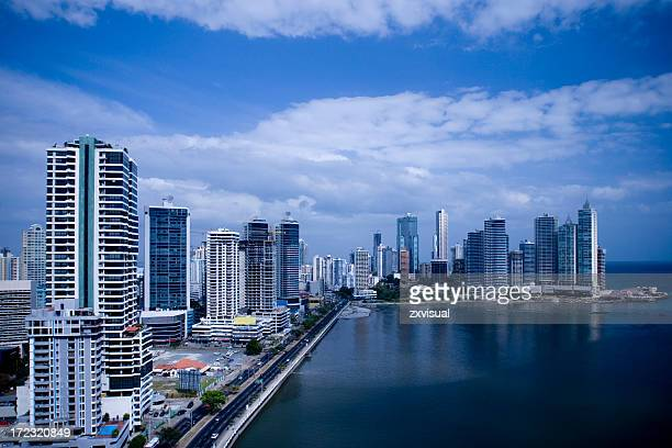skyline shot of a large city by the ocean - panama city panama stock pictures, royalty-free photos & images