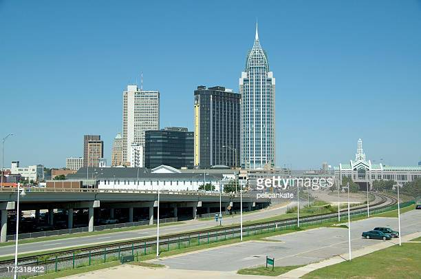 Skyline view of a city with buildings and a highway