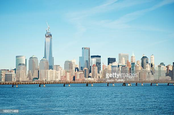 CONTENT] A skyline view of downtown Manhattan NY from Liberty State Park New Jersey Freedom tower under construction and bridge in foreground