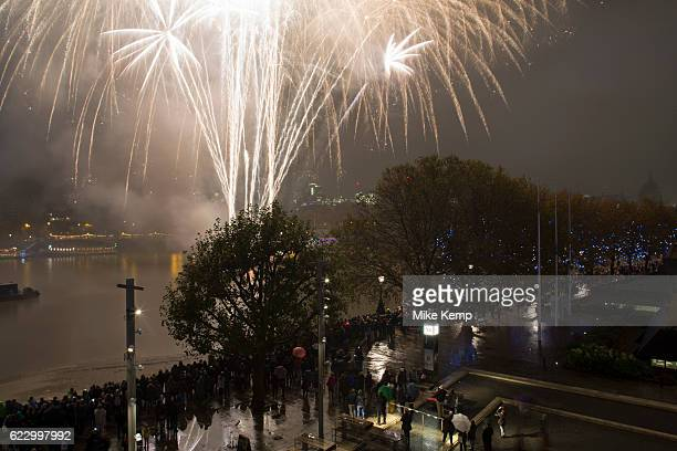 Skyline view of people gathered on the South Bank of the River Thames to watch the fireworks display for the Lord Mayor's Show on November 12th 2016...