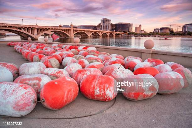 skyline view of tempe arizona and the mill avenue bridge - tempe arizona stock pictures, royalty-free photos & images