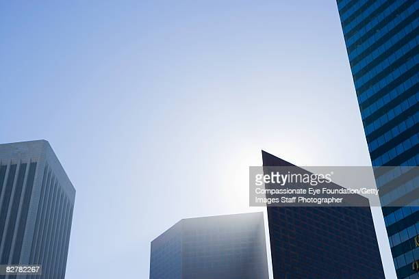 "skyline with building eclipsing the sun - ""compassionate eye"" stock-fotos und bilder"