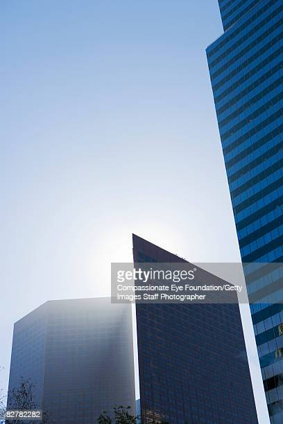 "skyline with building eclipsing the sun - ""compassionate eye"" fotografías e imágenes de stock"