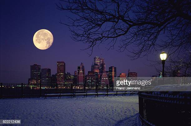 skyline with full moon in winter at night, new york city, manhattan, usa - snow moon stock pictures, royalty-free photos & images