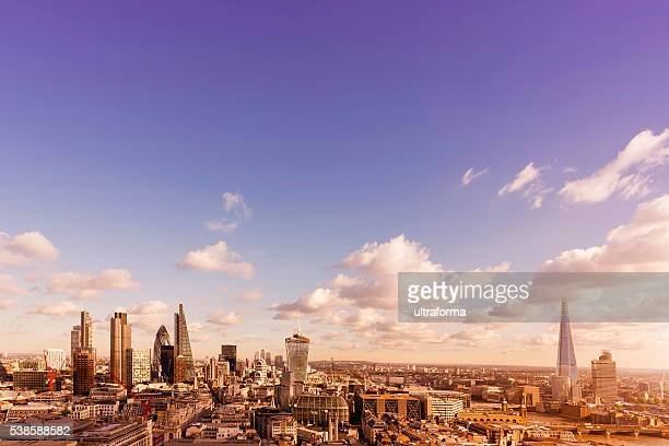 skyline with landmarks of london at sunset - canary wharf stock photos and pictures