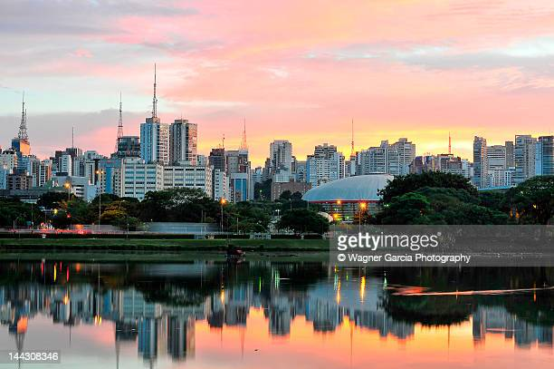 Skyline with reflections on lake at sunrise