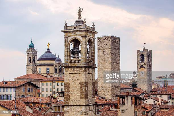 skyline with towers in bergamo, lombardy, italy - bergame photos et images de collection