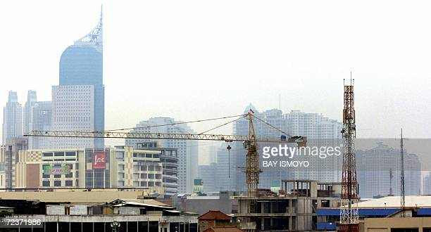 Skylines looks are masked by polluted air in Jakarta 03 November 2006 Indonesia will need around 125 billion USD in infrastructure investment during...