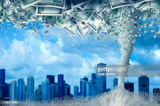 skylines of cityscape and storm of money tornado over cloudy sky - 改革 ストックフォトと画像