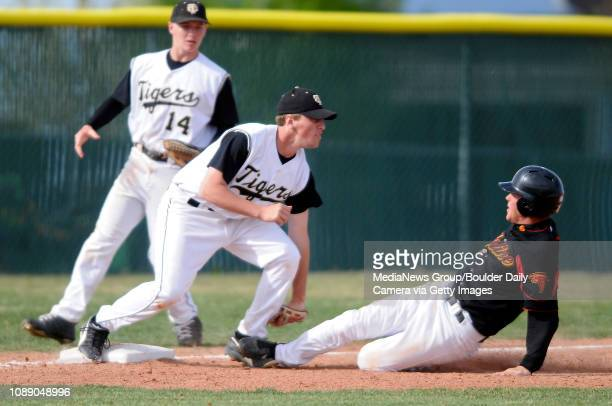 Skyline's Shane Zaruba is tagged out by Canyon City's Spencer Stringari trying to advance on a sacrifice fly during their district baseball game in...