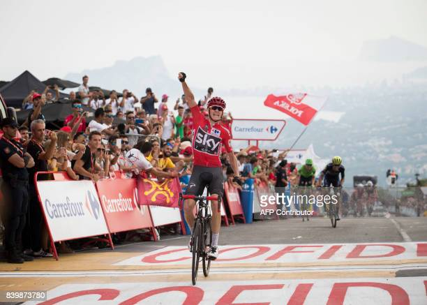 Sky's British cyclist Chris Froome celebrates as he crosses the finish line to win the 9th stage of the 72nd edition of La Vuelta Tour of Spain...