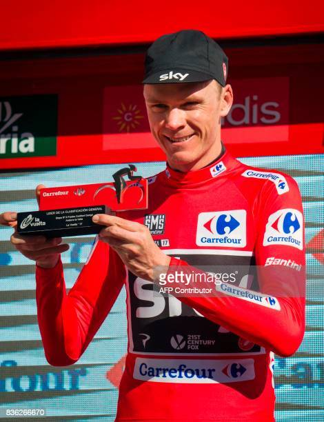 Sky's British cyclist Chris Froome poses on the podium with the leader's red jersey at the end of the 3rd stage of the 72nd edition of 'La Vuelta'...