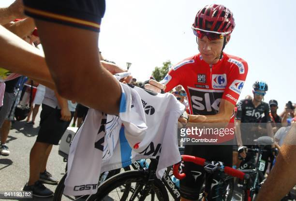 Sky's British cyclist Chris Froome signs autographs before the 12th stage of the 72nd edition of 'La Vuelta' Tour of Spain cycling race a 16001 km...