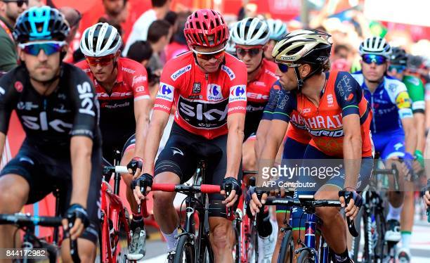 Sky's British cyclist Christopher Froome and BahrainMerida's Italian cyclist Vicenzo Nibali cross the finish line of the 19th stage of the 72nd...