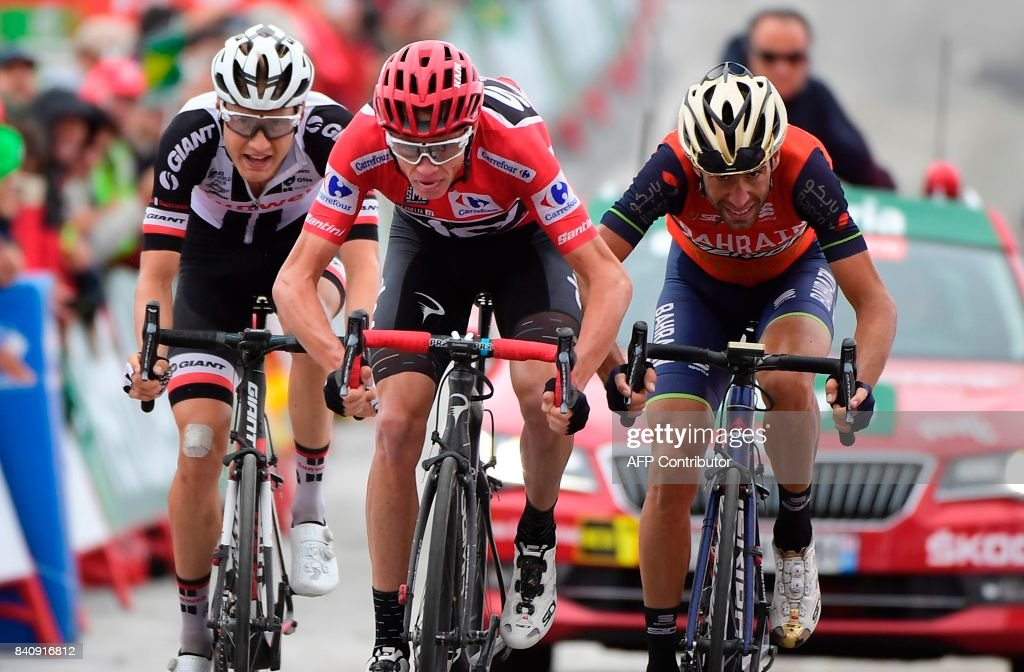 Sky's British cyclist Christopher Froome (C), Bahrain-Merida's Italian Cyclist Vicenzo Nibali (R), Sunweb's Dutch cyclist Wilco Kelderman cross the finish line of the 11th stage during the 72nd edition of 'La Vuelta' Tour of Spain cycling race, a 187,50 km route between Lorca to Calar Alto on August 30, 2017. /