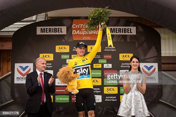 Sky's English rider Christopher Froome celebrates his yellow jersey on the podium during the seventh stage of the 68th edition of the Dauphine...