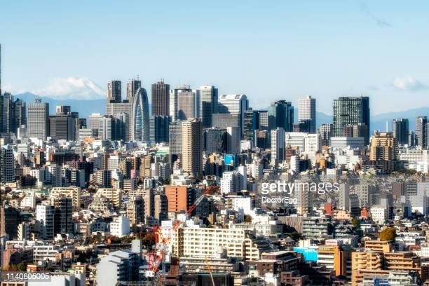 skyscraper buildings with fuji mountain background at shinjuku district, tokyo, japan - japan economy stock pictures, royalty-free photos & images